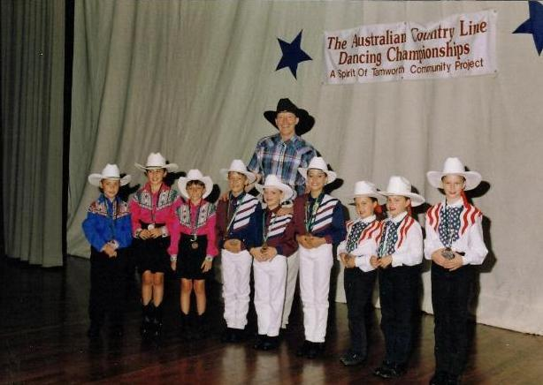 Bill Bader Presenting the Junior Trio Champions of the Australian Line Dance Championships 1998