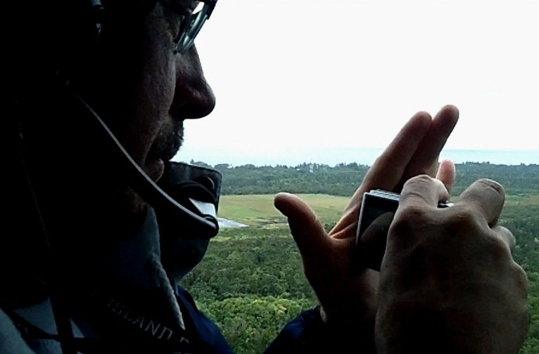 Grant videoing as the helicopter takes off from Hilo