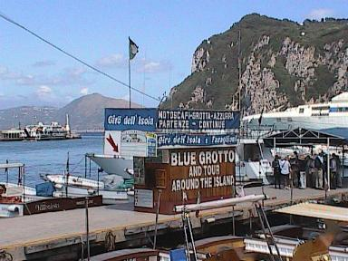 Capri-BlueGrottoTourShackWIthCliffsBehind